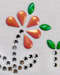 Flower nailhead and rhinestone design
