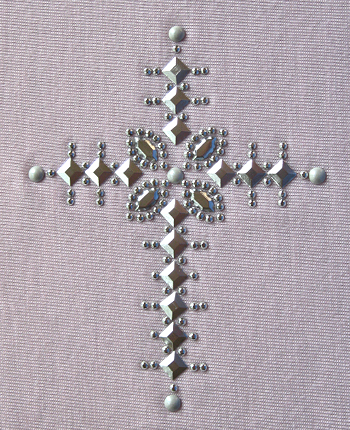 Cross nailhead and rhinestud design